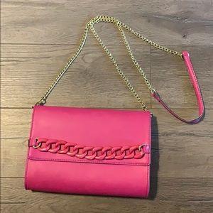 Pink Gianni Bini crossbody clutch with chain strap